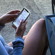 Woman uses her smartphone