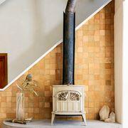 Room, Furniture, Shelf, Interior design, Wall, Fireplace, Living room, Hearth, Beige, Floor,