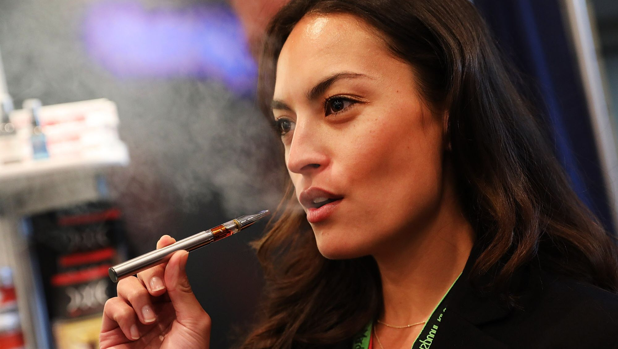 An attendee vapes a CBD oil pen made from hemp at the Cannabis World Congress Conference on June 16, 2017 in New York City.