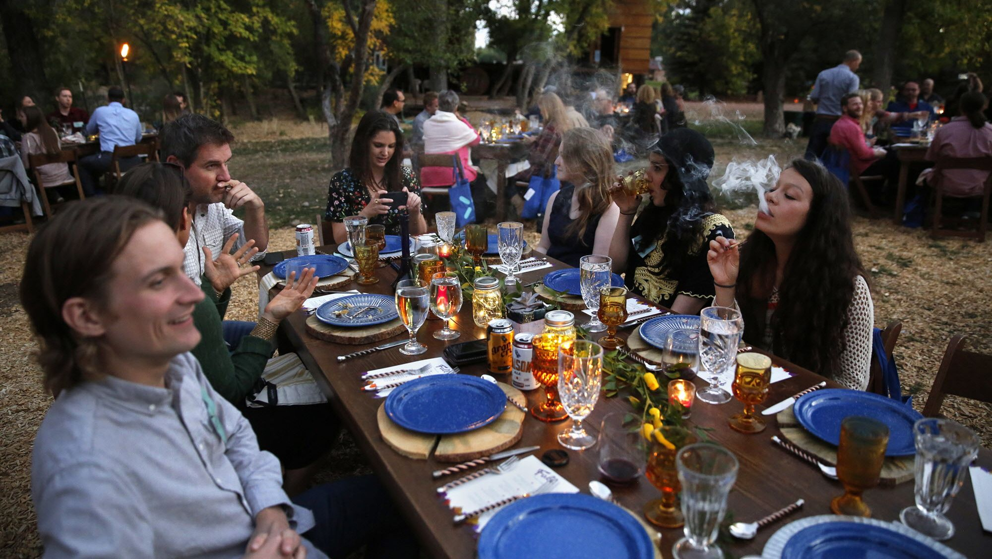 Guests dining at Planet Bluegrass, an outdoor venue in Lyons, Colo. (AP Photo/Brennan Linsley, File)