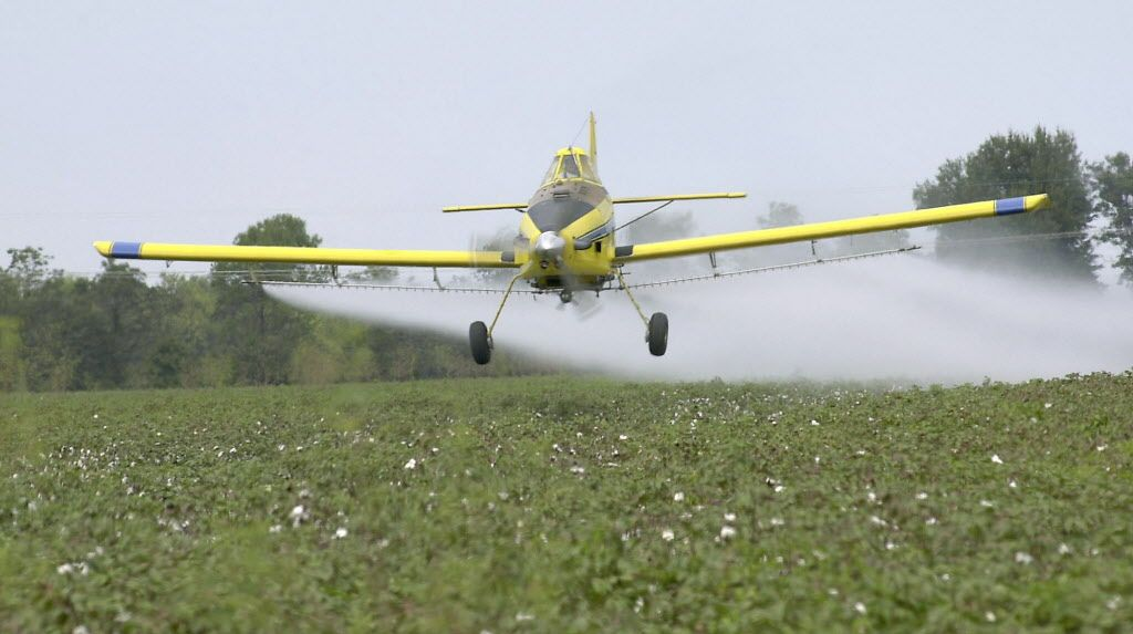 Up to 30 percent of pesticides applied by farmers land on neighboring farms. (File photo | Jim Lytle, for AP)