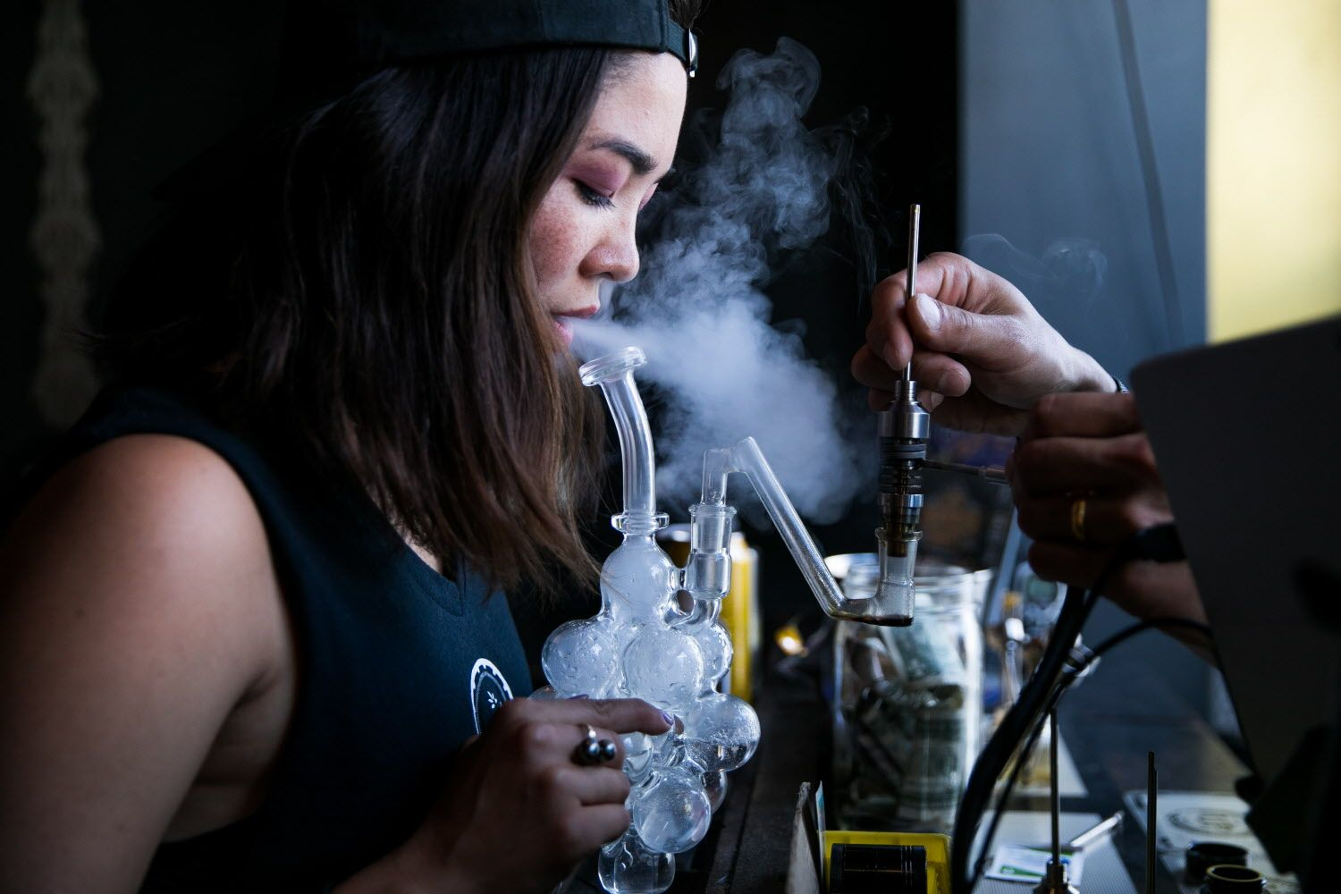 Midori Mel blows vapor after using the dab rig at Urban Pharm in San Francisco, Calif. Saturday, August 5, 2017.