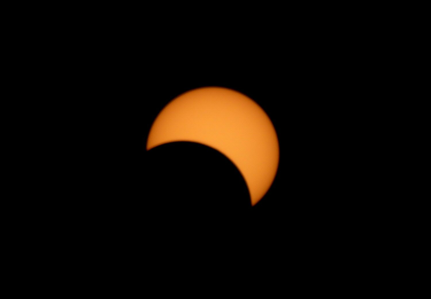 A partial solar eclipse is seen in Jakarta, Indonesia, Wednesday, March 9, 2016. (AP Photo/Achmad Ibrahim)