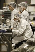 Lab technicians including  extract technician Alex Kato (left) and Cuong Nguyen (middle right) check lab results at R&D in Kiva's chocolate factory on Friday, August 11, 2017, in Oakland, Calif..