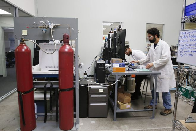 Jibril Kyser (l to r) Steep Hill lab technician/research assistant  and Alexander Zitoli, Steep Hill senior lab technician, work in the chemical testing/safety lab at Steep Hill Labs  on Monday, June 26, 2017 in Berkeley, Calif.