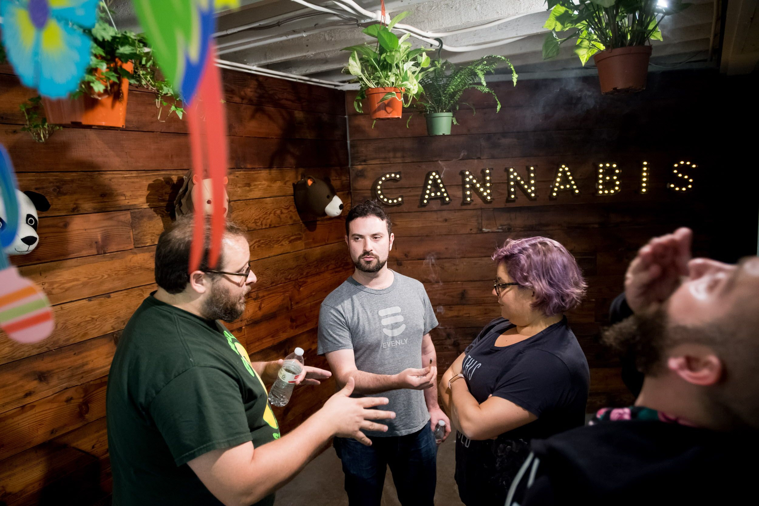 Joe Hankin, center, shares pot with fellow participants at Puff, Pass & POTtery gathering on Wednesday, May 24, 2017, in Oakland, Calif.