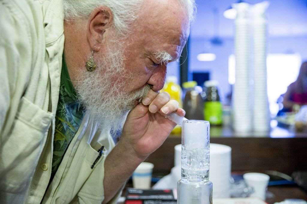 Michael Grafton, also known as Grand Daddy Mike, smokes marijuana out of a vaporizer during the East Bay Senior Social Club at the Magnolia Dispensary on Friday, Aug. 18, 2017, in Oakland, Calif.