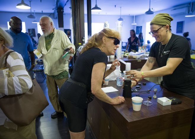 Mary Ann Blackwell (center) smokes marijuana out of a vaporizer during the East Bay Senior Social Club at the Magnolia Dispensary on Friday, Aug. 18, 2017, in Oakland, Calif. Photo by: Santiago Mejia