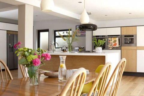 Room, Wood, Yellow, Interior design, Furniture, Table, Ceiling, Light fixture, Floor, Interior design,