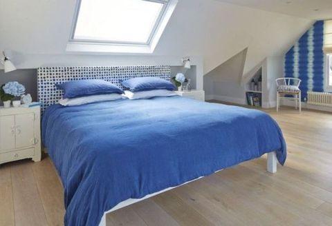 Blue, Wood, Floor, Room, Interior design, Bed, Flooring, Property, Bedding, Bedroom,