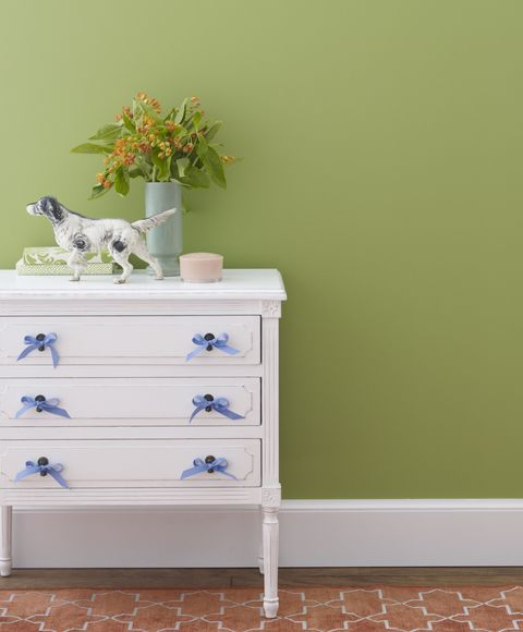 Green walls and white storage table
