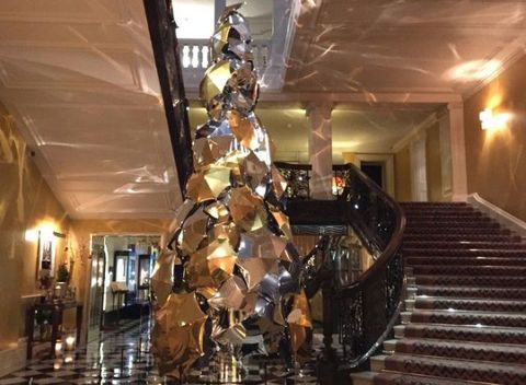 Lighting, Stairs, Ceiling, Interior design, Light fixture, Sculpture, Hall, Ceiling fixture, Handrail,