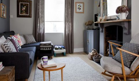 A cosy dark grey living room furnished with upcycled and ...