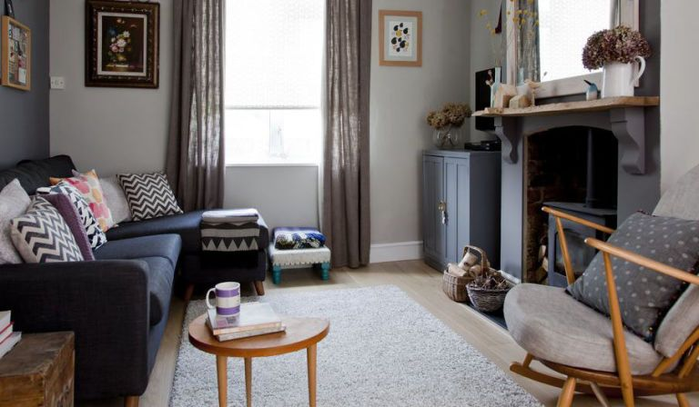 A cosy dark grey living room furnished with upcycled and vintage pieces