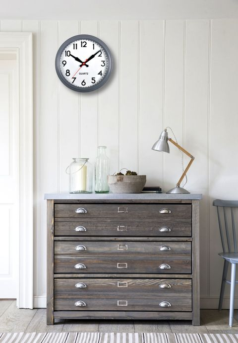 Garden training cabinet with clock