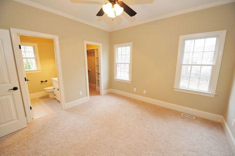 Wood, Room, Floor, Yellow, Flooring, Interior design, Property, Ceiling fan, Ceiling, Wall,