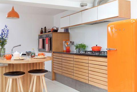 Kitchen renovation in Waddingham using retro Danish styling and an orange Smeg fridge
