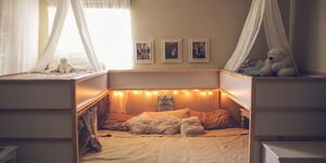 Ikea family bed hack from Texas couple Elizabeth and Tom Boyce and their five children. This mega bed was made using two Ikea kura beds.