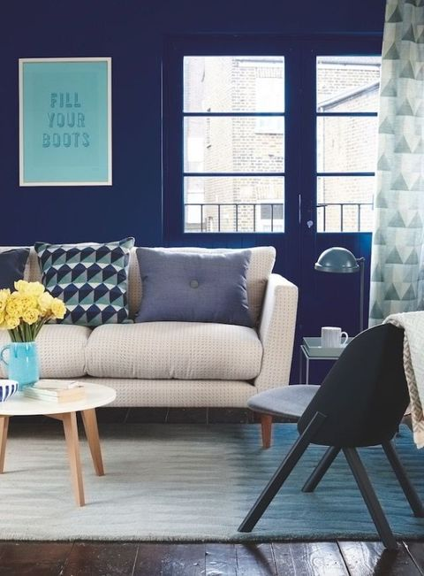Deep blue hue furniture walls with modern geometrics