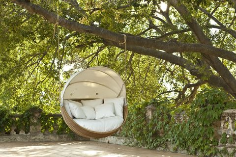 Point Armadillo swinging garden sofa chair is contemporary outdoor furniture.