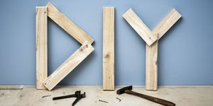 Wooden planks forming the letters DIY for 'Do It Yourself'