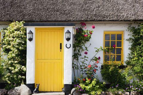 Yellow front door, front garden, Ballyvaghan, County Clare, Ireland