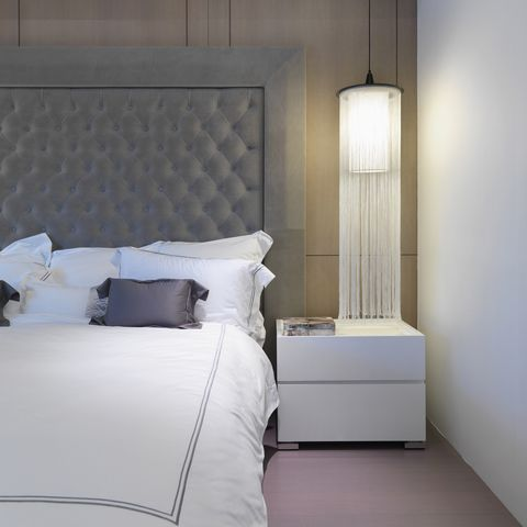 White bed with elegant headboard