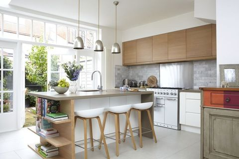 Modern Open Plan Kitchen And Dining Room Is A Storage Dream
