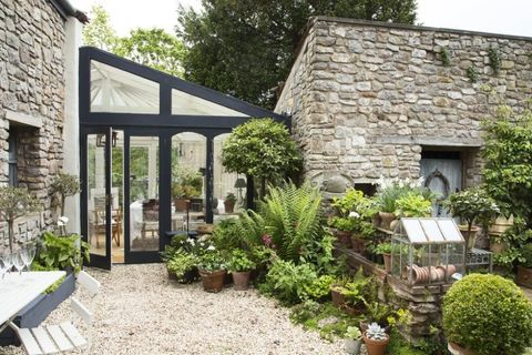 Courtyard garden boasts stone walls, scented plants and potted ...
