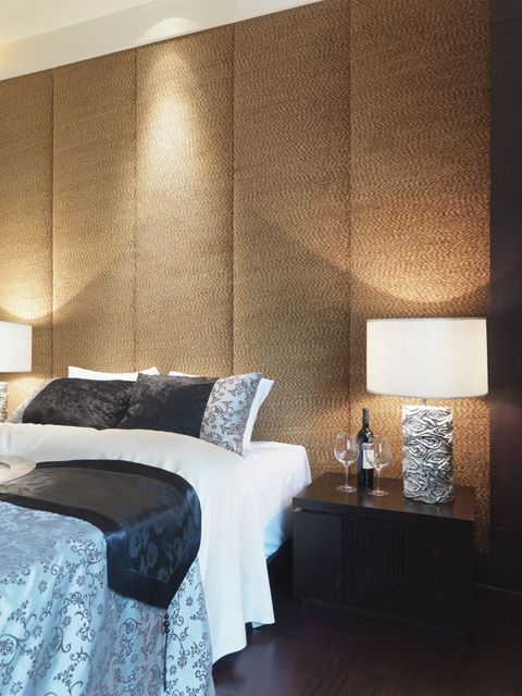 Textured wall behind bed, upholstered wall