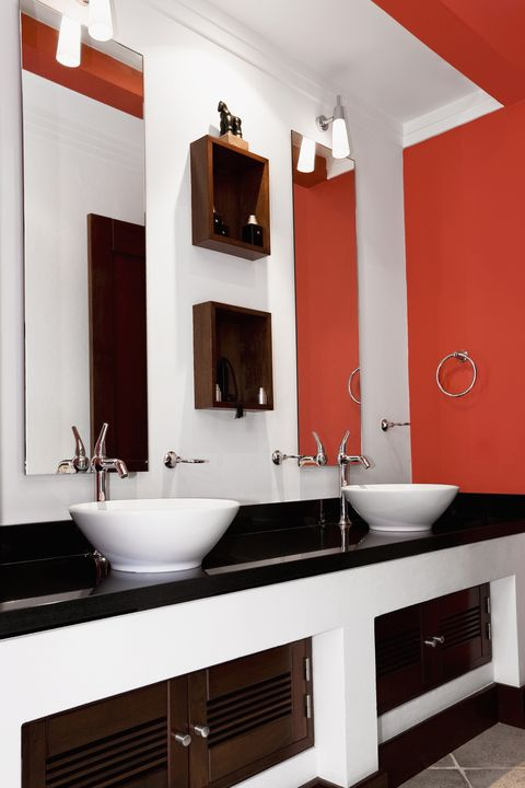 Interiors of a bathroom with orange walls