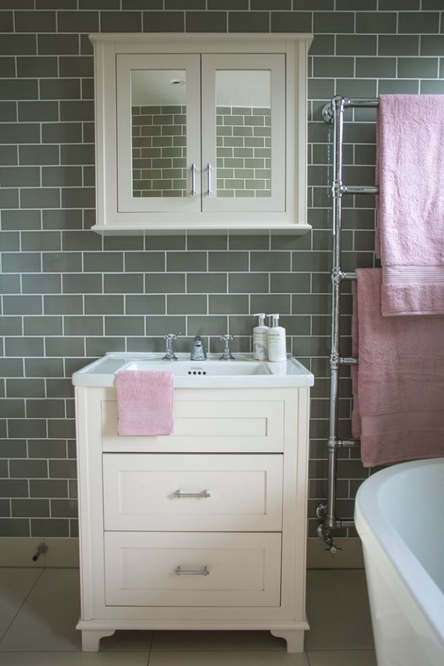 bathroom makeover grey brick tiles and pink accessories makes this rh housebeautiful com pink and gray bathroom decor pink and grey bathrooms