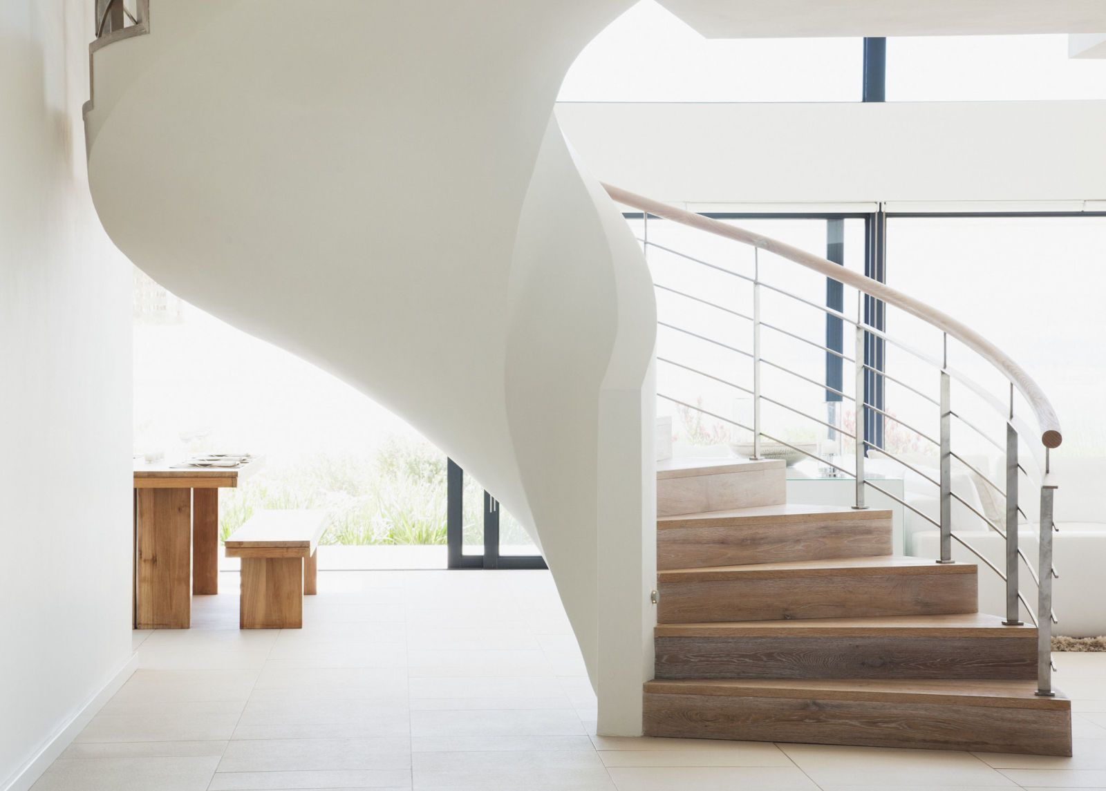 Curving Staircase In Modern Home. Getty ImagesMartin Barraud