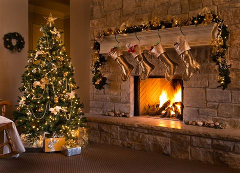 a beautiful contemporary gold themed christmas eve fireplace tree stockings and living - Under Christmas Tree Decorations