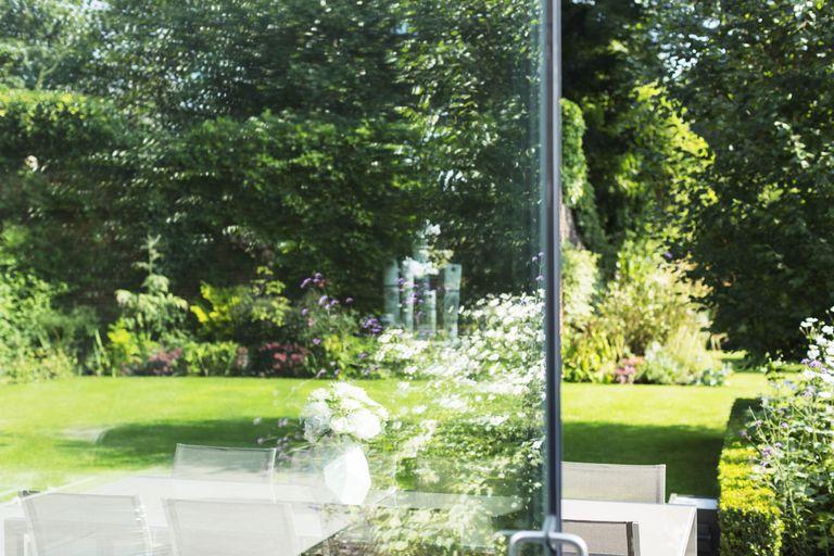 4 reasons why you should plan a garden redesign in winter view of landscaped garden through open door workwithnaturefo