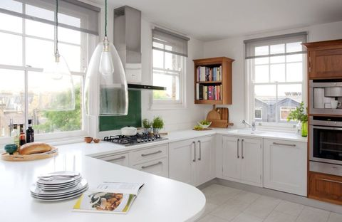 Two Uncovered Windows Transform Kitchen Into Light Filled Room