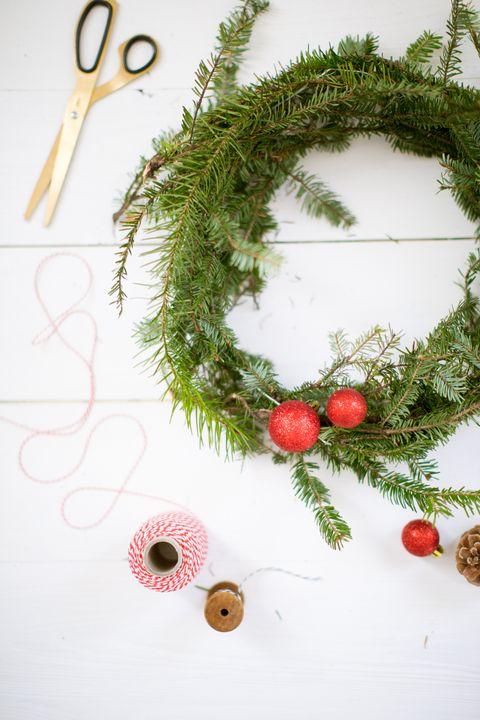 Christmas wreath, scissors, thread, baubles