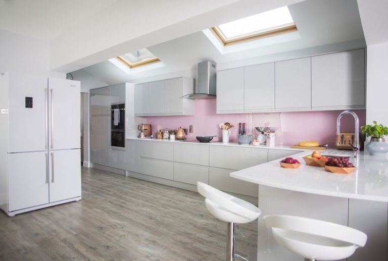 Pink, grey and copper colours gives this kitchen makeover an ...