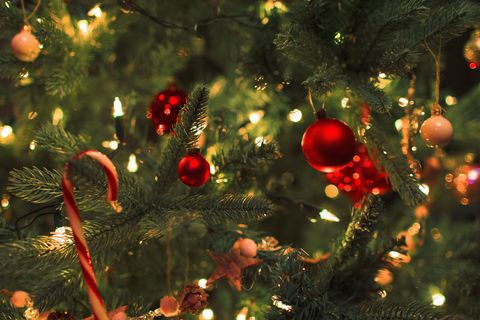 close up ornaments and string lights on christmas tree - How To String Lights On A Christmas Tree