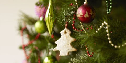 Close up of Christmas tree with baubles and Christmas biscuits