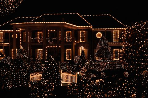 House Illuminated By Christmas Lights