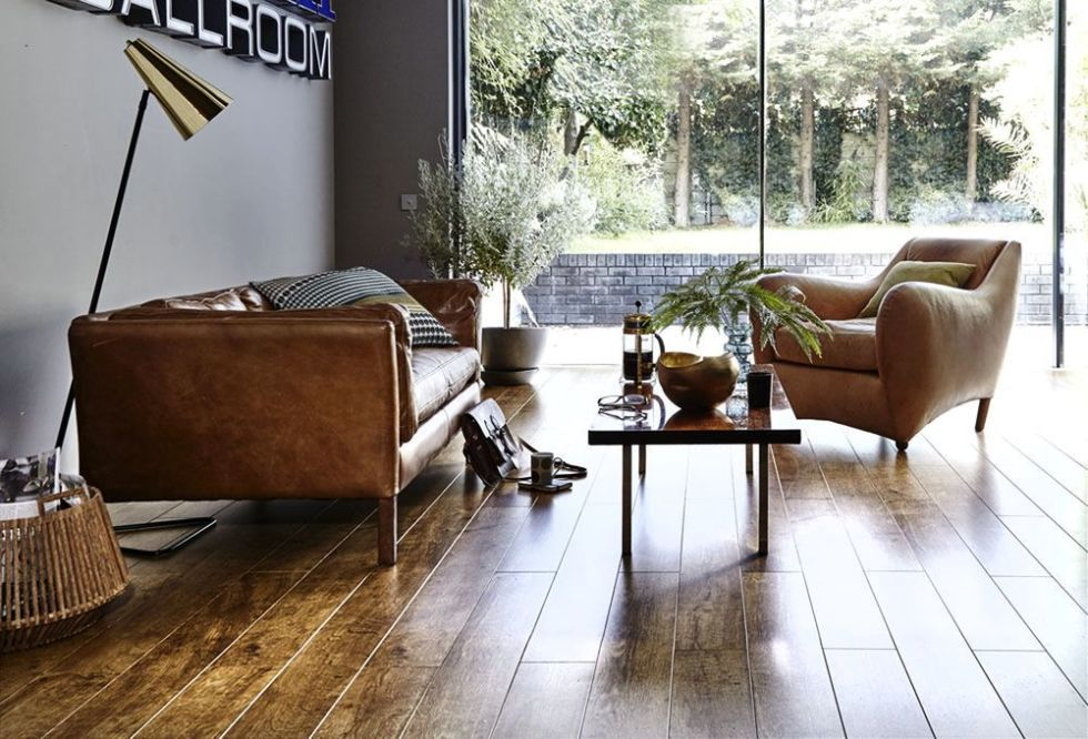 wood or carpet for your living room follow these flooring tips rh housebeautiful com