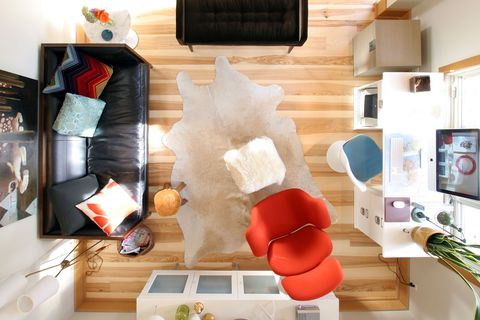 Looking down on a colorful and modern living room. Hardwood floors, colorful furniture,modern interior