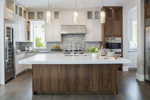 Kitchen with white surface tops and minimalist design