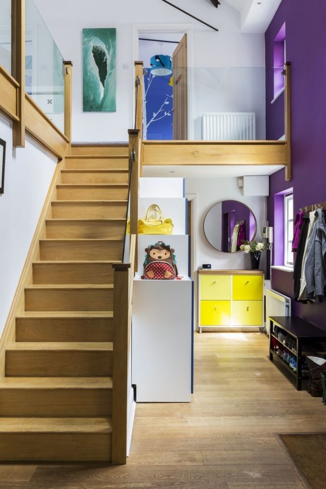 Hallway Painted With Bright Bold Colours Of Yellow And Purple, With Wooden  Staircase