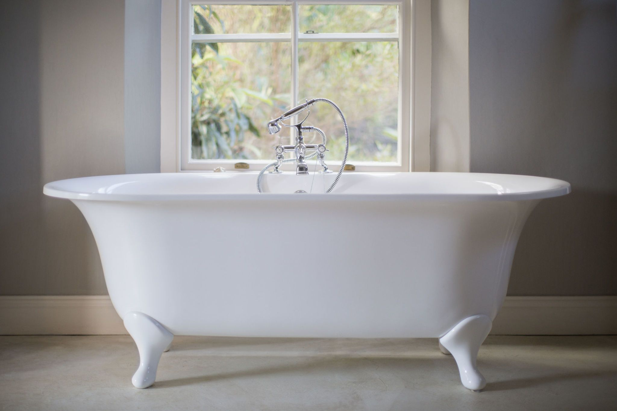 Freestanding White Bath In Bare Bathroom