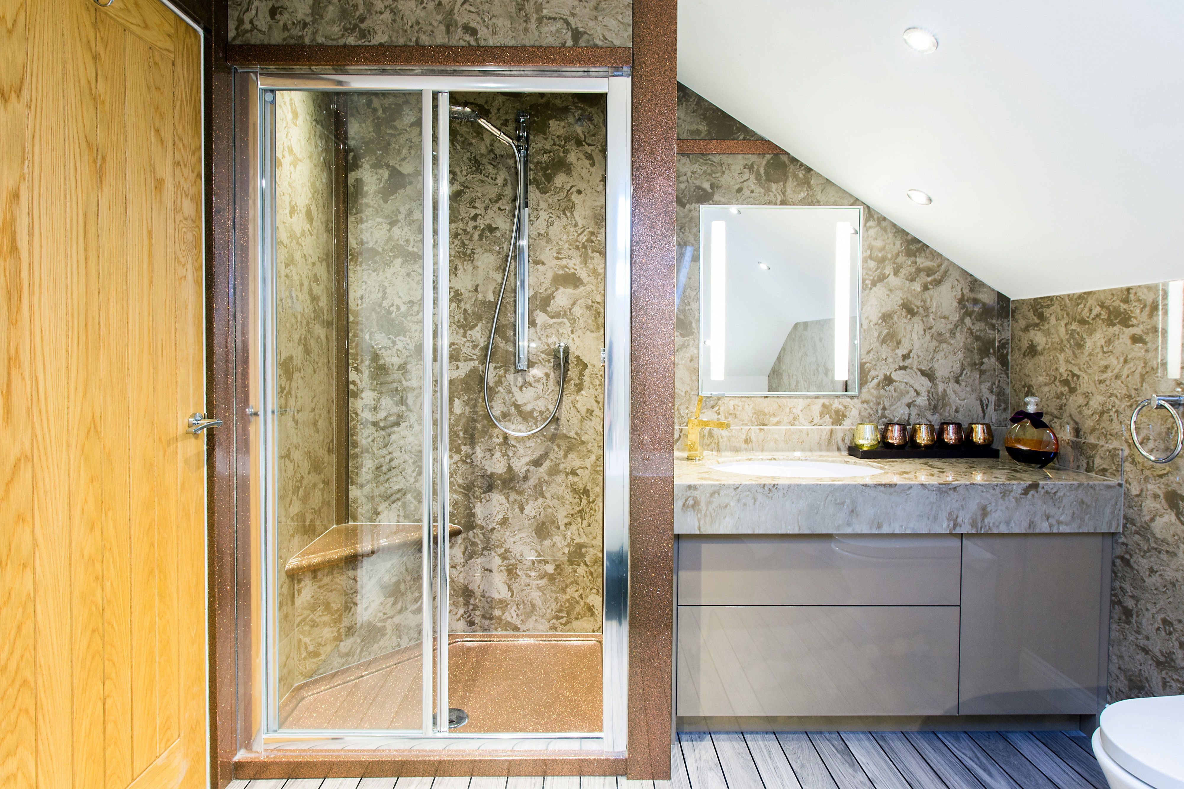 Bathroom With Green Marble Walls And Striped Panel Flooring