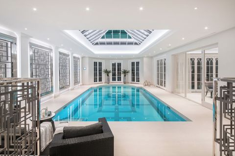 There\'s a swimming pool hidden under this ballroom floor
