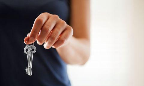 Woman holding a set of keys