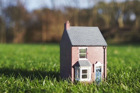 Model of house sits on lawn